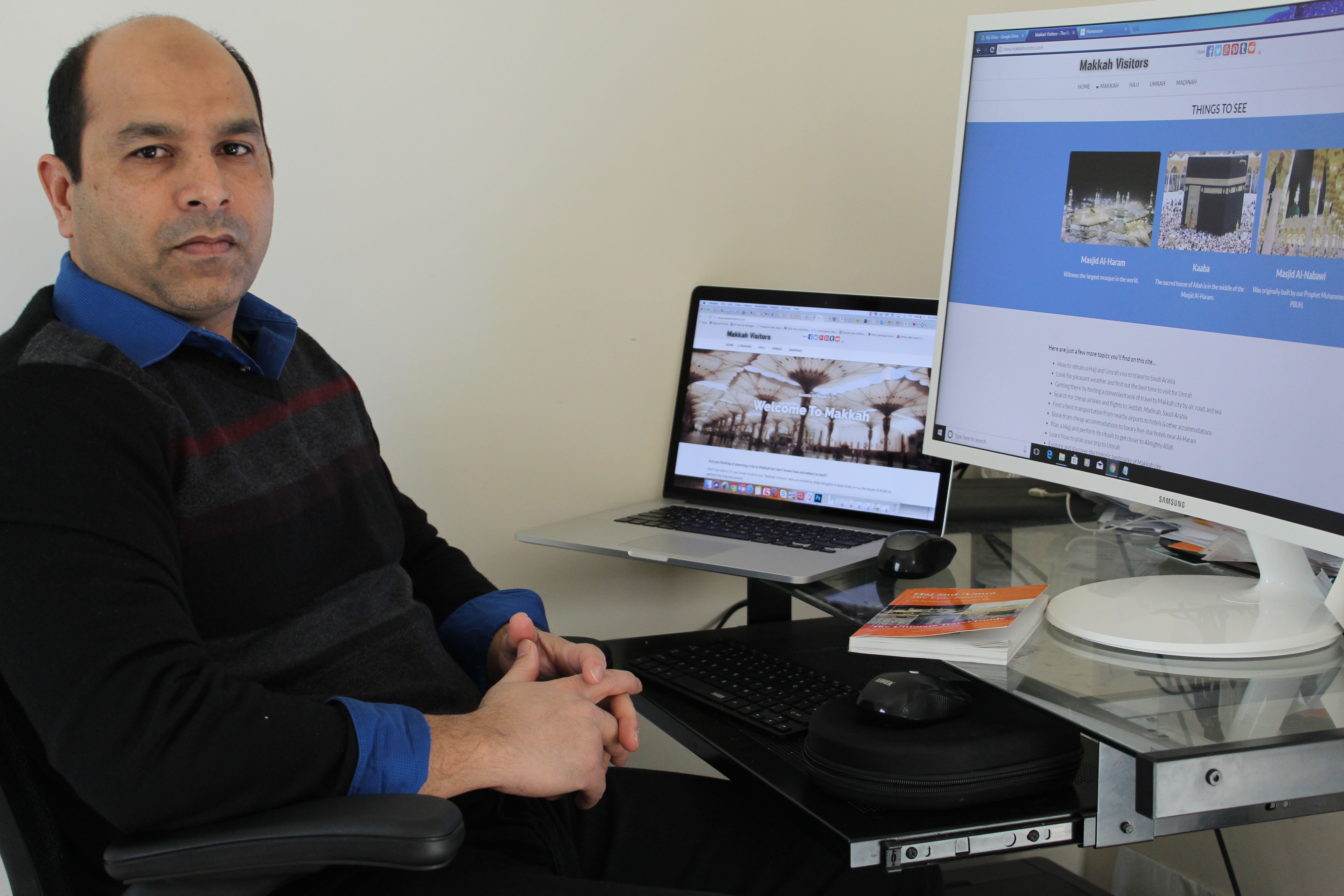 Here, I am sitting in front of computer and working on building MakkahVisitors.com website.